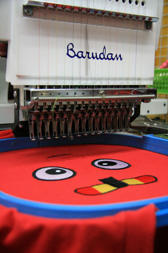 automated t-shirt embroidery via an embroidery machine